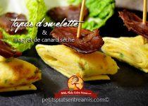 Tapas d'omelette et de magret de canard séché.